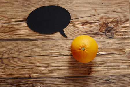 southsea: orange with speech bubble on wooden surface Stock Photo