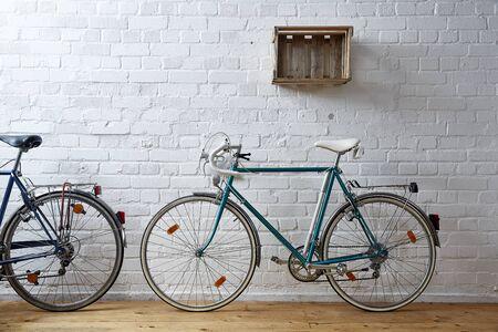wine road: vintage bicycle in whitebrick studio