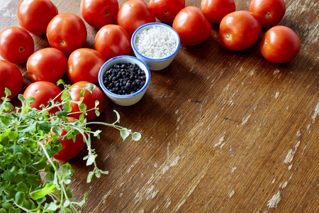 nightshade: kitchen scene with tomatoes and herbs