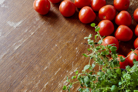 nightshade: tomatoes and herbs in kitchen Stock Photo