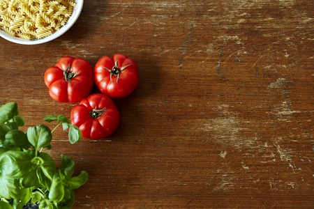 tarpaulin: rich kitchen scene with tomatoes herbs and pasta