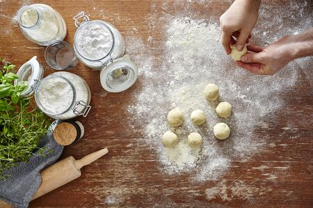 semolina pasta: homemade pasta baking in kitchen hands forming dough Stock Photo
