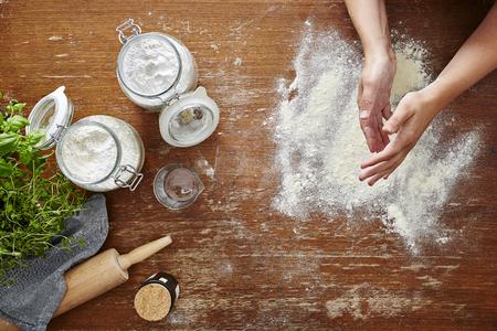 floury hands in kitchen scene homemade pasta
