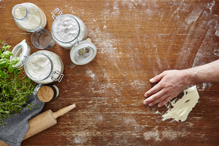 homemade pasta baking in kitchen hand wiping flour