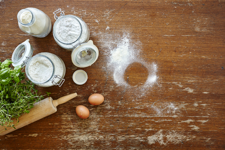 retain: baking scene flour and eggs on wooden table Stock Photo
