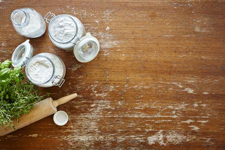 kitchen scene baking jars with flour wooden table Stock Photo