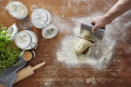 hand cutting dough atmospheric kitchen