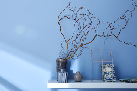 decorated shelf on blue wall modern interior design