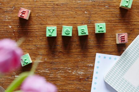 letter stamps forming the word yeah