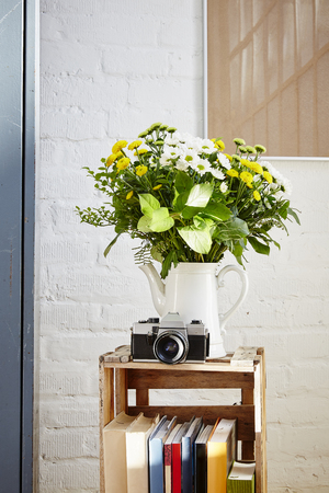 flowers in pitcher vivid light vintage decoration Stock Photo