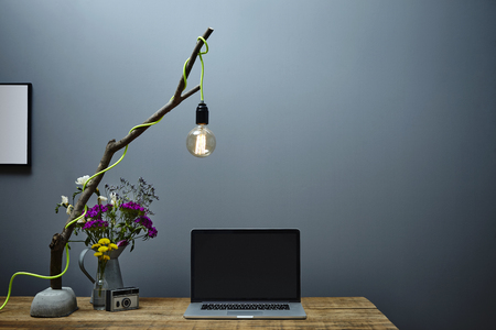 urban office unique illumination branch lamp and laptop