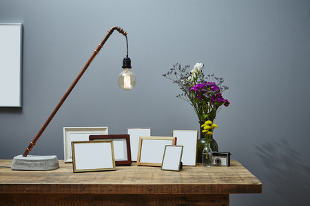 individual urban interior design copper lamp picture frames and flowers