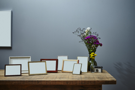 vintage sideboard with bunch of picture frames urban interior design Stock Photo