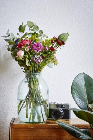 wild bunch of flowers in hipster design atmosphere vivid interior design Stock Photo