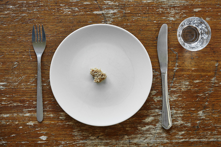 small bread crumb on plate hunger starvation and malnutrition