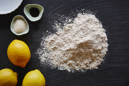 baking a lemon pie ingredients on dark table