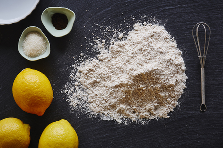homemade baking ingredients for lemon cake black and yellow contrast Stock Photo