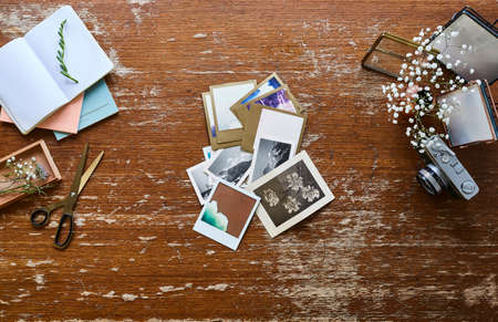 creative workspace photographer sorting vintage pictures