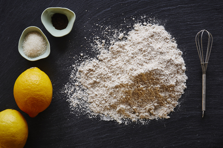 food blog making a lemon pie flour lemons on dark surface Stock Photo