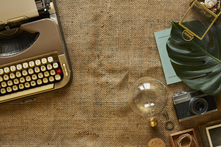 writing a novel old school vintage typewriter and collection of gadgets Stok Fotoğraf