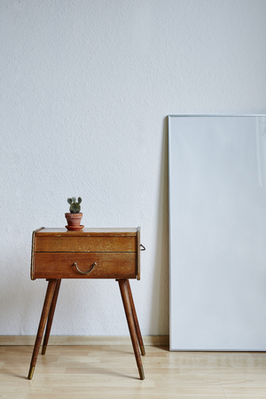 minimalist interior design cactus chest drawer and frame Stock Photo