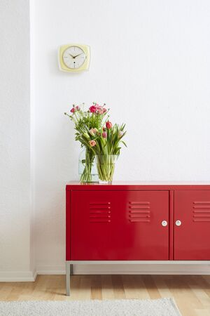 minimalist home decoration flowers on metal locker