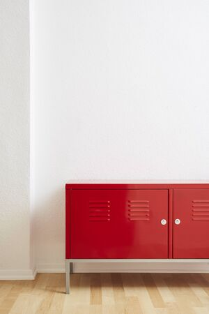 red locker white wall wooden floor in vivid light
