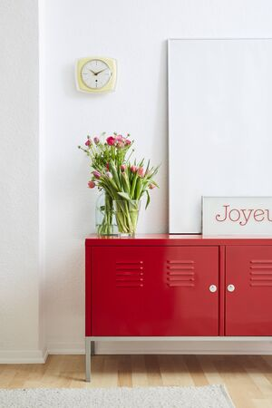 minimalist concept frames flowers and red metal locker