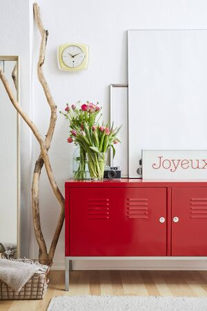 red locker flowers and picture frames lifestyle decoration Stock Photo