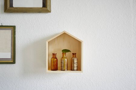 wall decoration flasks in wooden house