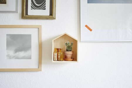 salon hang and wooden house with cactus