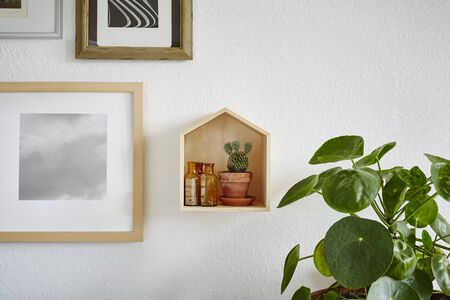 salon hang wall decoration with cactus and wooden house Stock Photo