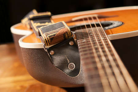 strap: Classic guitar detail with strap.