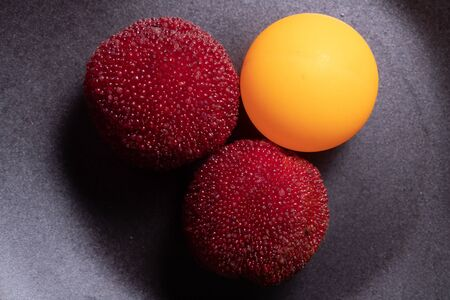 Chinese bayberries and table tennis ball