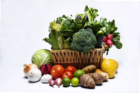 green leafy vegetables: Basketfull of green leafy vegetables and other produce in variety of colors and shapes.