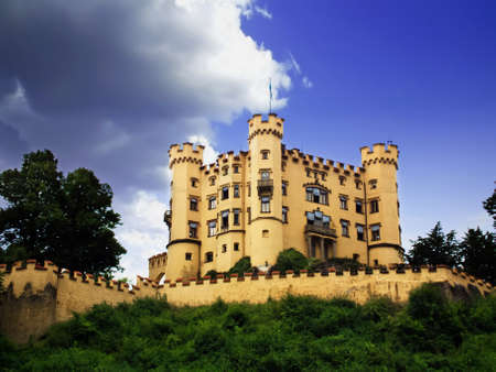 Castle Hohenschwangau in South Bavaria. Summer landscape with a medieval castle in Germany.