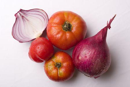 tomatos: tomatos and onions on white Stock Photo