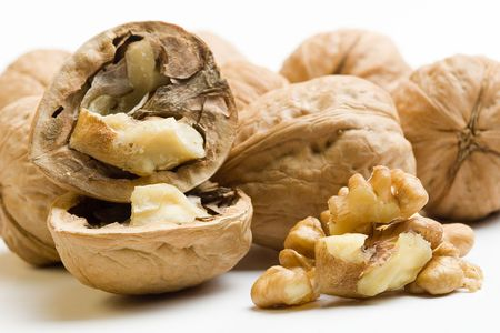composition with nuts, one of them opened, and pulp of nut