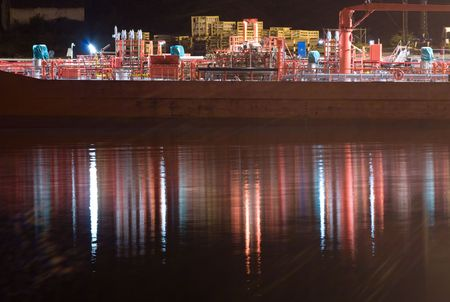Boat in a port at night with reflections photo