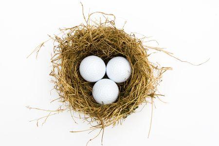 three golf balls in a nest photo