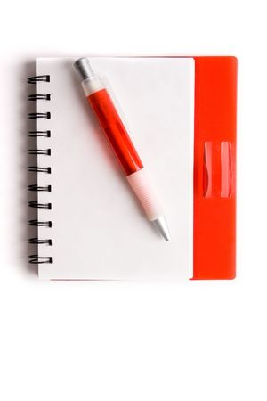 bloc: red notebook and ball point pen over white background