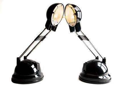 ignited: two ignited black lamps on white bottom Stock Photo