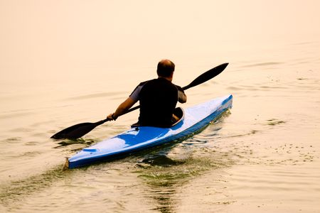 rower with canoe training in a lake