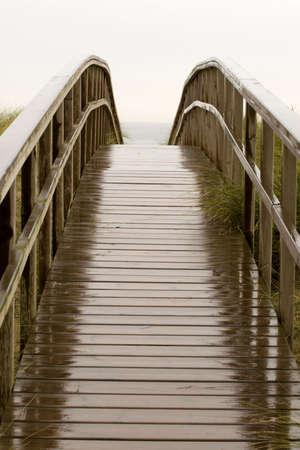 wood footbridge wet in the rain