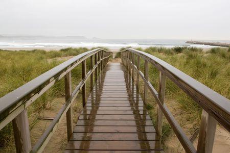 footway: wood footbridge wet in the rain