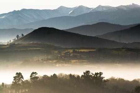 Vespertine foggy landscape in Asturias, north of Spain Standard-Bild