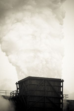 Industrial facilities emitting great amount of smoke. The atmosphere is dirty and tone increases that sensation Stock Photo