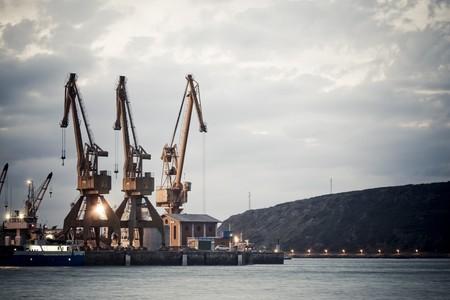 Derricks of load of the industrial maritime port of Native of Avila, Asturias, north of Spain
