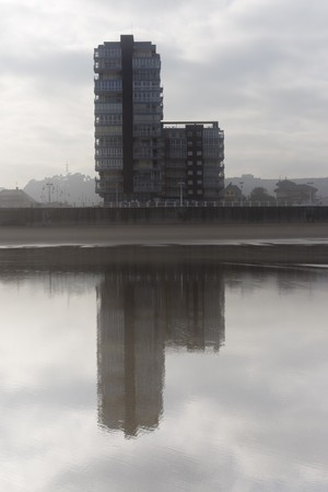 vapour: Salinas, Asturias, north of Spain, between the fog and reflected in its beach in low tide Stock Photo