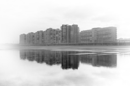 murk: Salinas, Asturias, north of Spain, between the fog and reflected in its beach in low tide. Black and White